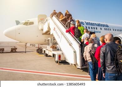 Kyiv/Ukraine - 04.20.2019: Passengers boarding into the plane of Ukraine International Airlines.