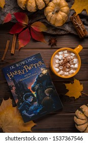 Kyiv/Ukraine - 21.10.2019: Harry Potter book in autumn flat lay with pumpkins and yellow leaves.