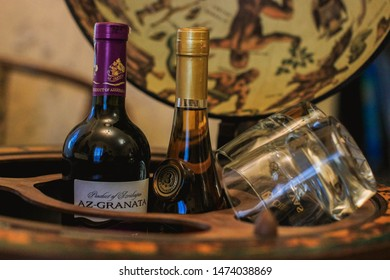 Kyiv/Ukraine - 9 August, 2019: Wooden Globe bar with bottle storage on casters with the bottles of alcohol and glasses inside (Azerbaijan wine, brandy). Az Granata. Beautiful decor. Luxury present