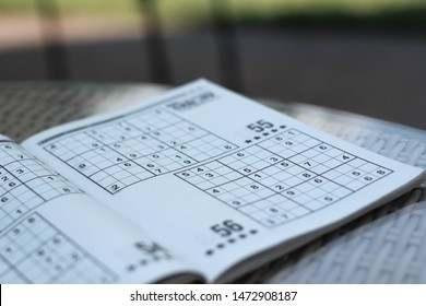 "Kyiv/Ukraine - August 7,2019: Solving sudoku, logical-based, number puzzle. Also called ""Number place"". Improves memory. Good for brain."