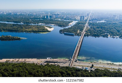 KYIV,UKRAINE-21 JUNE,2018: Aerial drone photo of beautiful bridge over river Dnepr in Kiev city.Flying camera landscape shot of popular touristic area