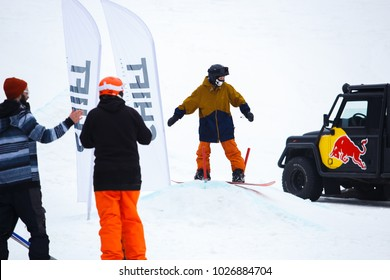 KYIV,UKRAINE-3 FEBRUARY,2018:Snowboard park Goloseev Ski Park opening.Cool young snow board athlete rides down the track on high speed at winter extreme sports competition in park