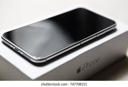 KYIV,UKRAINE-3 NOVEMBER,2017:New Iphone X out of the box in mobile phone store.Newest Apple Iphone 10 smartphone on white branded Apple brand box