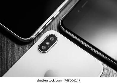KYIV,UKRAINE-3 NOVEMBER,2017:New Iphone X smartphone model in close up.Newest white Apple Iphone 10 mobile phone & other phones with touch screen.Top expensive wireless gadget to stay always connected