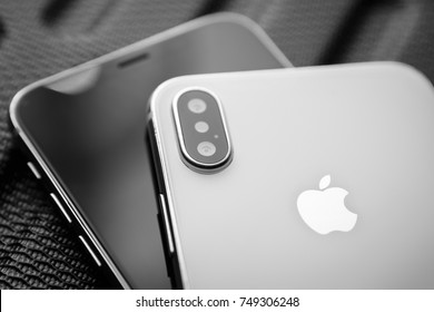 KYIV,UKRAINE-3 NOVEMBER,2017:Two new Iphone X smartphones in close up.Newest white Apple Iphone 10 mobile phone devices.Couple of black and white luxury cellphone gadgets