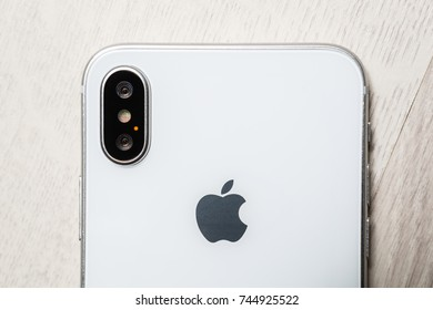 KYIV,UKRAINE-9 OCTOBER,2017:Iphone X mobile phone in close up on white wooden background.Latest Apple Iphone 10 mobile phone.Illustrative editorial.