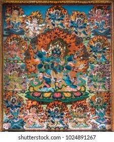Kylakuppe,India - October 29, 2013: Inside Padmasambhava Vihara of Namdroling Buddhist Monastery. Hell two: Devi Kali feet trampling humans. Vivid colors. Fire and skulls.