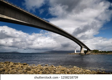 Kyleakin, Isle of Skye, Scotland, UK - June 15, 2018: Skye Bridge to Isle of Skye over Kyle Akin Strait from Inner Sound to Loch Alsh and Eilean Ban Island with white Kyleakin lighthouse Scotland