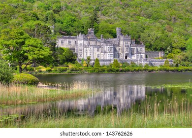 Kylemore Abbey among trees and forest reflected in lake  , Connemara , Ireland