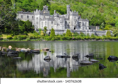 Kylemore Abbey reflected in green water lake , Mayo county  , Ireland