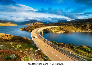 The Kylesku Bridge spanning Loch a' Chàirn Bhàin in the Scottish Highlands and a landmark on the North Coast 500 tourist driving route