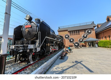 KYOTO - APR 8: Old locomotive at 19 century hall SL & piano museum on Apr 8, 14 in Kyoto. It is a museum for historic of train in Kyoto.