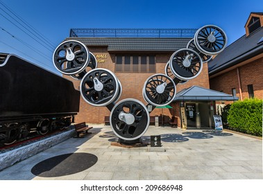 KYOTO - APR 8: Old locomotive wheels at 19 century hall SL & piano museum on Apr 8, 14 in Kyoto. It is a museum for historic of train in Kyoto.