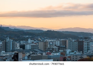 Kyoto city view with mountain range on the background.