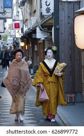 KYOTO - DEC 20: Unidentified Geisha walking with her teacher  by the famous Pontocho street on December 20, 2009 in Gion district, Kyoto, Japan. Geishas are girls skilled in traditional japanese arts.