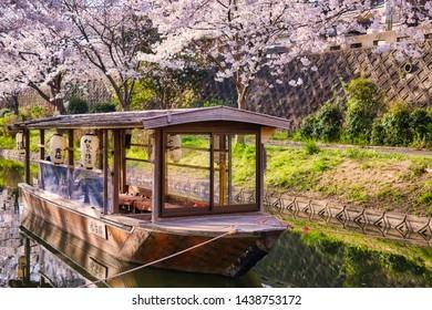 "Kyoto Fushimi Jyukkokubune Sanjyukkokubune during the Cherry Blossom season. Shot in kyoto, Japan. Translation: ""Sake of Fushimi, water ancient city"""