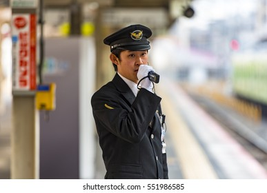 KYOTO - JAN 04: Japanese train conductor is on his duty on a platform in Kyoto on January 04. 2017 in Japan