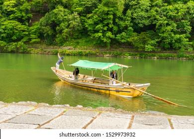 Kyoto / Japan - 06.24.2019: Traditional Japanese boat on Katsura river,