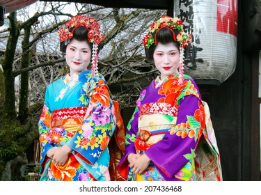 KYOTO, JAPAN - 11 FEBRUARY, 2012: Geisha Girls making a pilgrimage to Kiyomizu-dera Temple