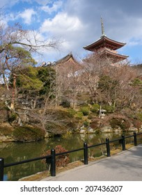 KYOTO, JAPAN - 11 FEBRUARY, 2012:The gardens of Kiyomizu-dera Temple looking back to the three storey pagoda.
