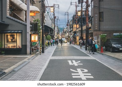 Kyoto, Japan - 17 September 2017: Normal post-covid Japanese street life at small road with power lines in the evening