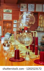 Kyoto, Japan - 2010: Empty Yama siphon coffee brewer at a cafe