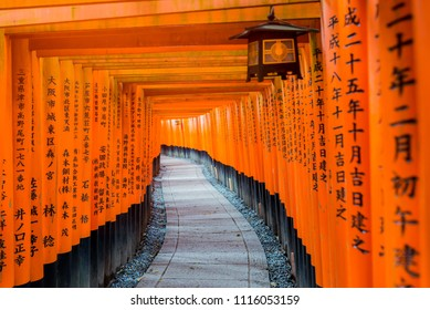 KYOTO, JAPAN - 2016  November 21 : Red wooden Tori Gate at Fushimi Inari Shrine in Kyoto, Japan. Fushimi Inari Shrine one of famous landmarks.