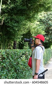 KYOTO - JAPAN - 21 JUL 2016 : Young man photographer is taking a photo