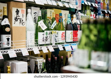 KYOTO, JAPAN - 23 APRIL, 2018: Different kinds of sake and other alcoholic beverages are on sale in one of the supermarkets in Kyoto, Japan.