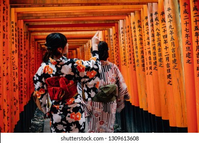 KYOTO, JAPAN - 3 Feb 2019 Women in traditional japanese kimonos walking at Fushimi Inari Shrine in Kyoto,One of famous landmarks in Kyoto, Japan