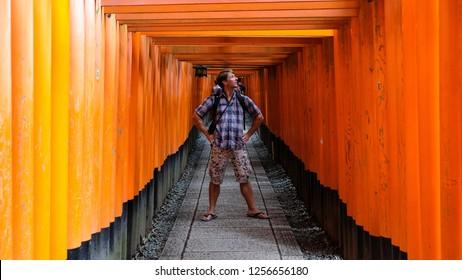 Kyoto, Japan - 31.7.2018. - European tourist posing in Fushimi Inari Shrine