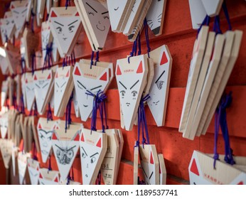 KYOTO, JAPAN - 9 NOVEMBER 2017 : Fox-shaped ema of Fushimi Inari shrine, Japanese wood plates (called Ema).