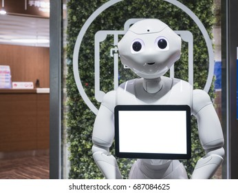 KYOTO, JAPAN - APR 14, 2017 : Pepper Robot Assistant with Information screen at Kyoto station Tourism Japan