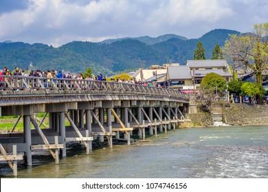 Kyoto, Japan - Apr,5 2017 : Crowded tourist people at Arashiyama bridge