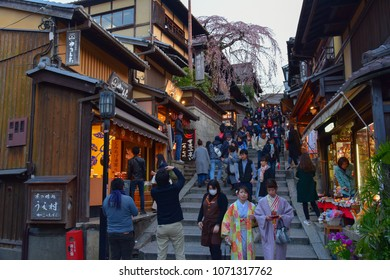 KYOTO, JAPAN - APRIL 1 2017: Tourists wander a famous street, Sannen Zaka, in Kyoto on April 10 2012.  The street is located in the heart of Kyoto attractions. Many souvenir shops can be found here.