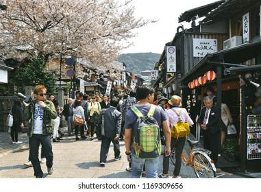KYOTO,  JAPAN - APRIL 10, 2014 : Street photography of people near Kiyomizu temple in Kyoto, Japan;