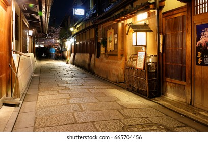 Kyoto, Japan - April 11, 2017: Tourists walking on an ancient street in Kyoto at night, Japan