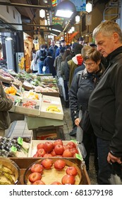 KYOTO, JAPAN - APRIL 11, 2017: European tourists are shopping for local Japanese fresh fruits at Nishiki market.