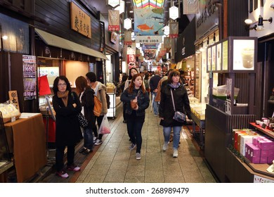 KYOTO, JAPAN -APRIL 13, 2015:  unidentified people walked along the famous Nishiki Market on April 13, 2015 in Kyoto Japan