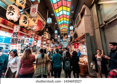 Kyoto, Japan - April 17, 2019: Many people shopping in covered roof Nishiki market arcade street shops for food and souvenirs