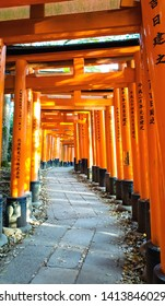 KYOTO, JAPAN – APRIL 18, 2019: Senbon torii along the main path around 10,000 torii gates at Fushimi Inari Taisha Shrine, kyoto Japan.