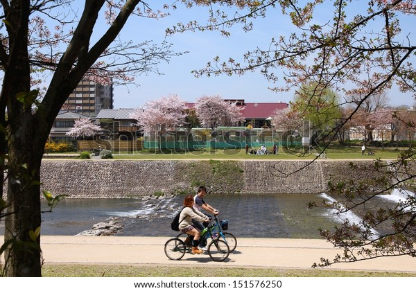 KYOTO, JAPAN - APRIL 18: People ride bicycles on April 18, 2012 in Kyoto, Japan. Kyoto is the former capital city of Japan, currently its 6th most populous city with 1.47 million citizens.