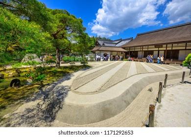 Kyoto, Japan - April 28, 2017: tourists around zen garden in Ginkakuji Temple. Ginshadan sand pattern representing the sea. Ginkaku-ji or Silver Pavilion, officially named Jisho-ji, is a Zen temple.
