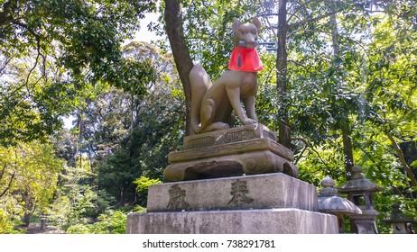 KYOTO, JAPAN - APRIL 28 : Fox Statues are often found in Fushimi Inari Taisha Shrine , one of famous landmarks in Kyoto on April 28, 2017 in Kyoto, Japan