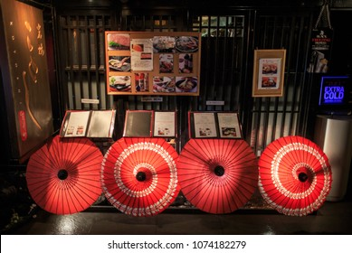 Kyoto, Japan - April 3, 2015: Multilingual menus in front of a colorful Japanese restaurant in Kiyamachi, one of the city's most popular nightspots