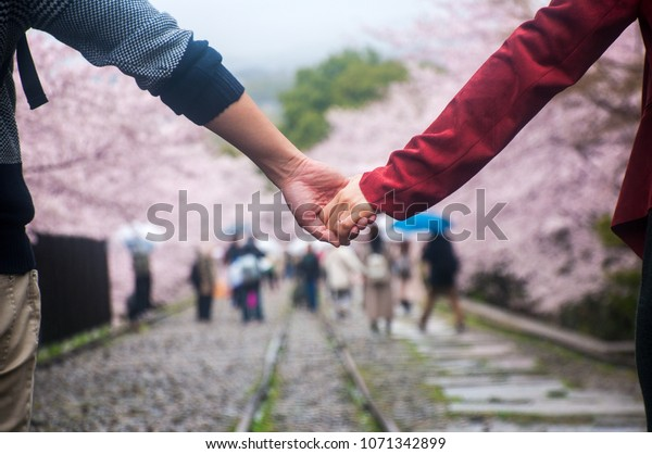 KYOTO, JAPAN - APRIL 4 2016 : lovely couple holding hands at Keage Incline, Kyoto
