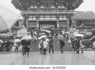KYOTO, JAPAN- APRIL 5, 2015: Many unidentified tourists visit Fushimi Inari Shrine ,black and white