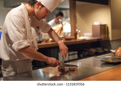 KYOTO, JAPAN - APRIL 7, 2013: Japanese chef prepares Kobe beef in a restaurant in the Gion district of Kyoto. Kobe beef is made by meat from Wagyu cattle.