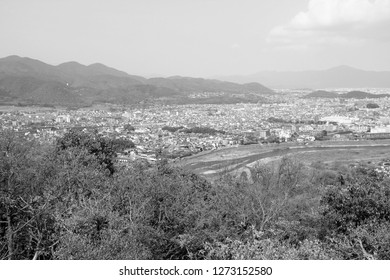 Kyoto, Japan - city in the region of Kansai. Aerial view with Katsura river and Ukyo ward. Black and white vintage style.