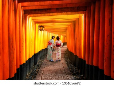 Kyoto, Japan Culture Travel - Asian traveler wearing traditional Japanese kimono walking in Fushimi Inari Shrine in the old town of Kyoto, Japan.